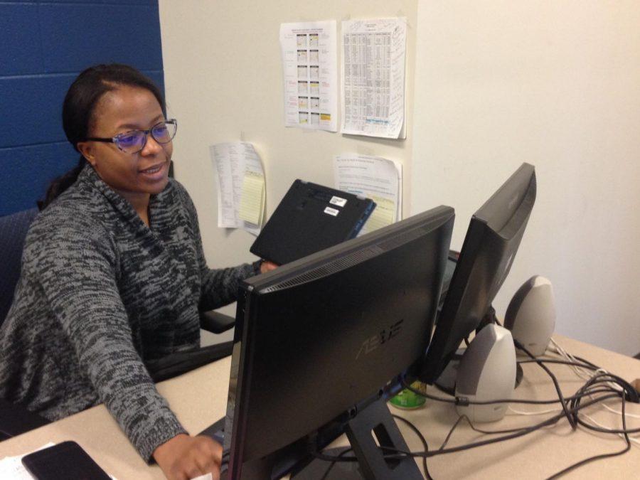 Roseline Ndumele works in her office.