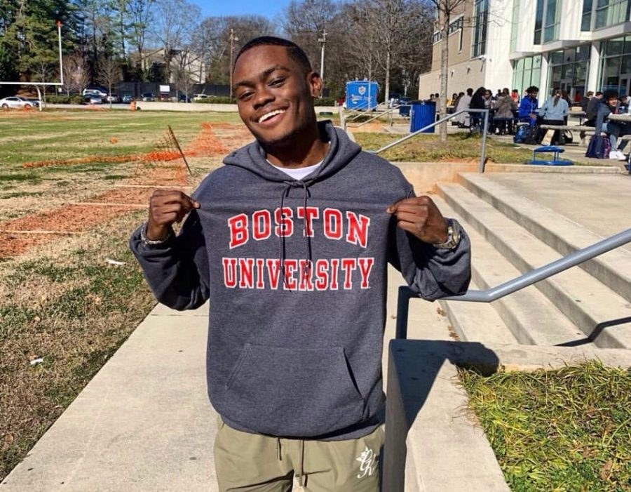 Senior+Robert+Felton+poses+in+his+Boston+University+hoodie.
