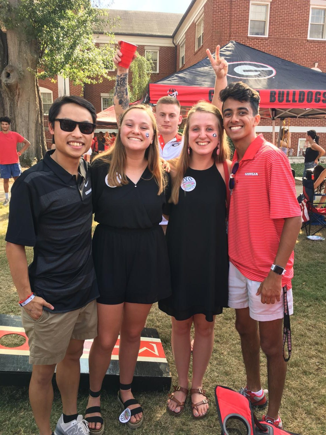 Freshman Thanh Nham poses with a group of friends at a party.