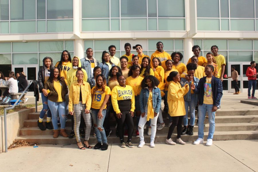 BeU+stands+together+in+yellow+for+their+Black+History+Month+movement.