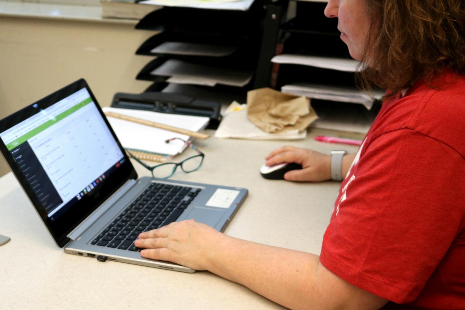 English teacher Jennifer Andriano visits Infinite Campus, used to view and input student grades.