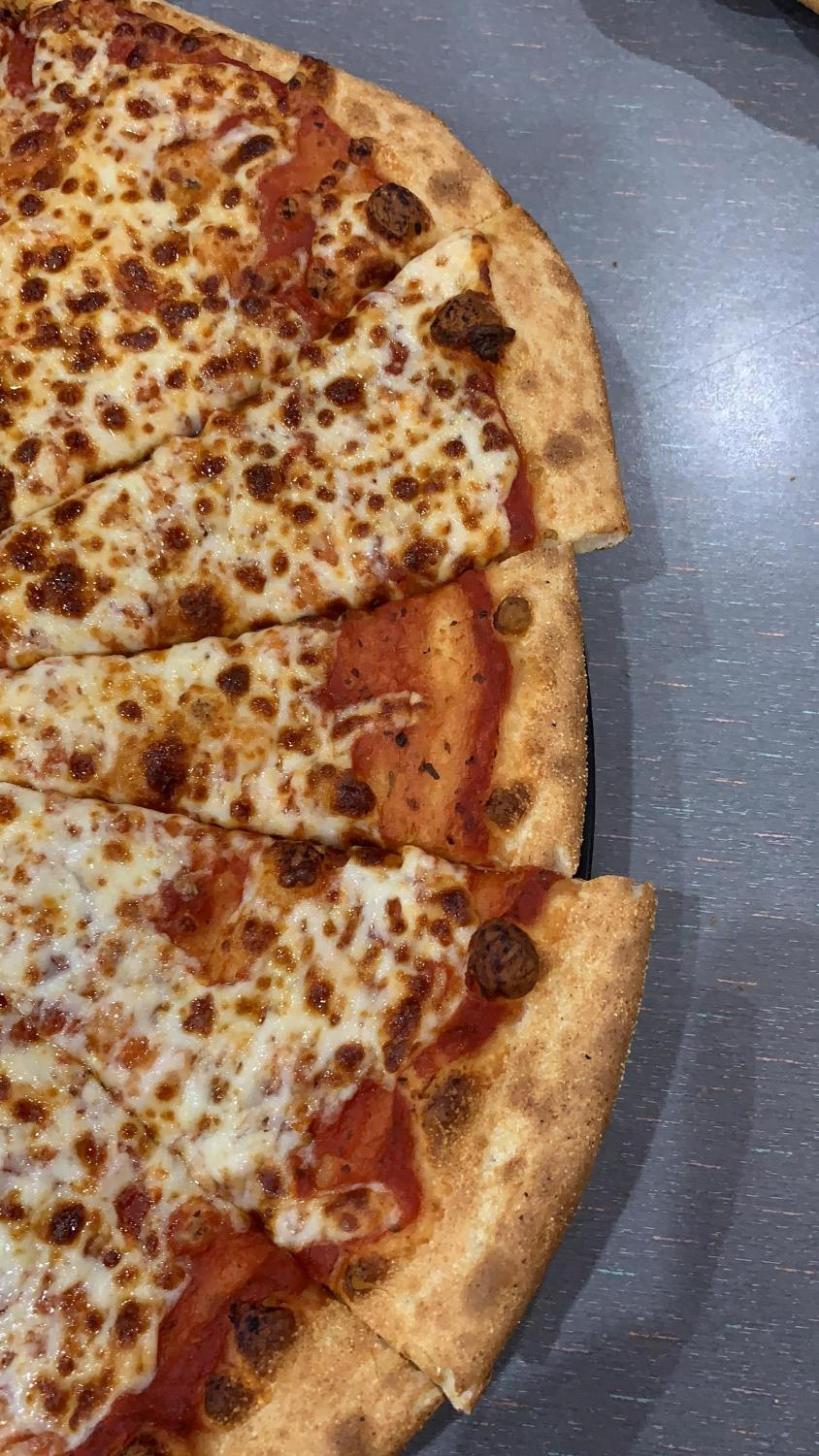 A suspiciously uneven Chuck E. Cheese's pizza.