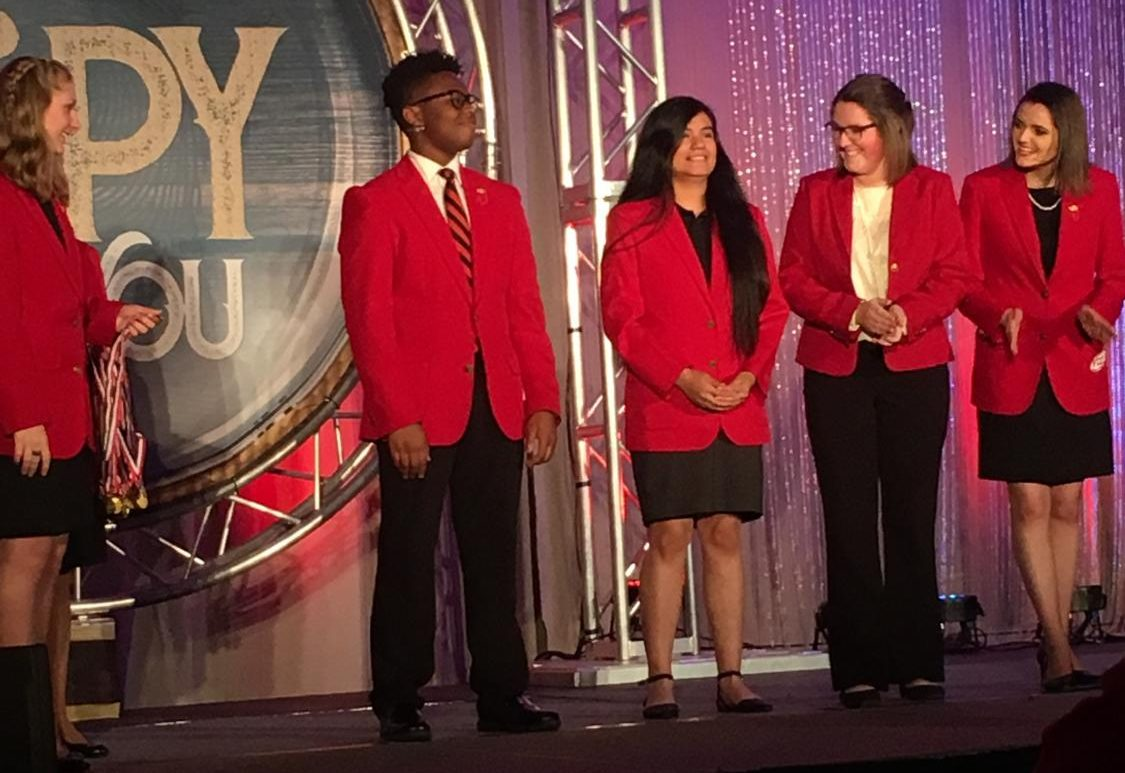 Maria Perez-Lopez, seen in the middle of the five,  stands with the rest of her FCCLA team.