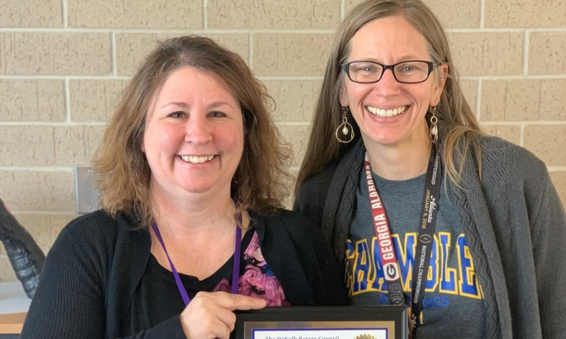Andriano (left) poses with Chamblee Principal Gail Barnes (right). Photo courtesy of Sam Brunson.