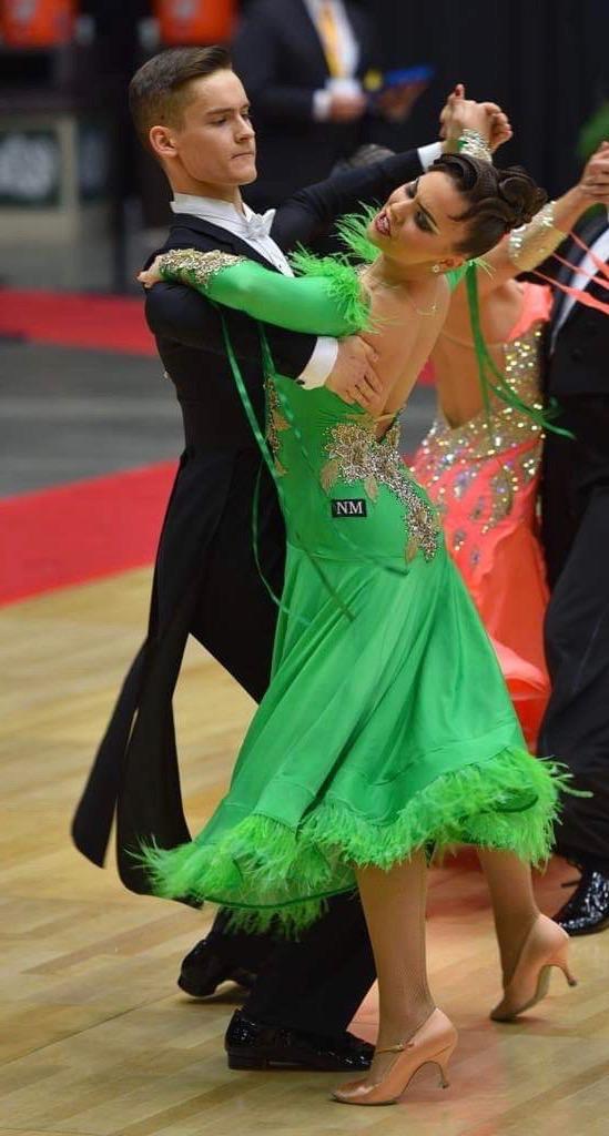 Madeleine Mravkarov dances with her partner in USA Ballroom National Championships.