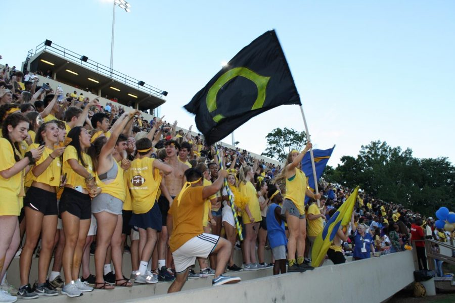Members of the spirit squad wave their flags and lead the CCHS student section in a cheer.
