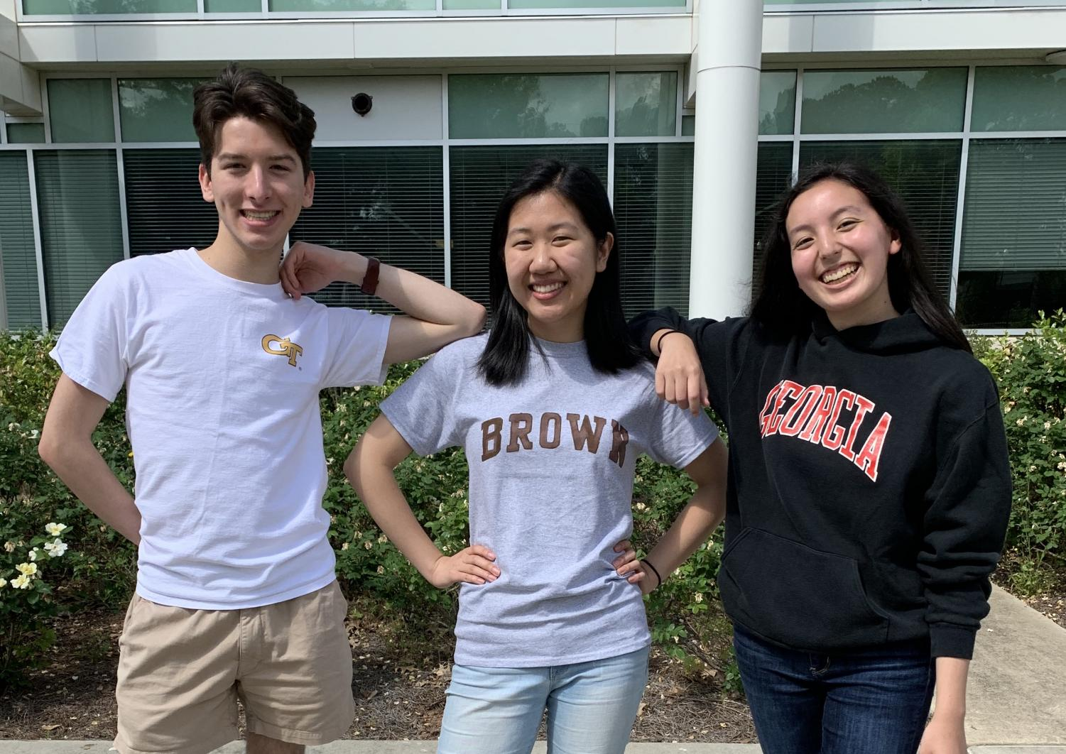 Alice Bai (center) stands with her fellow editors on College Decision Day. She chose Brown.