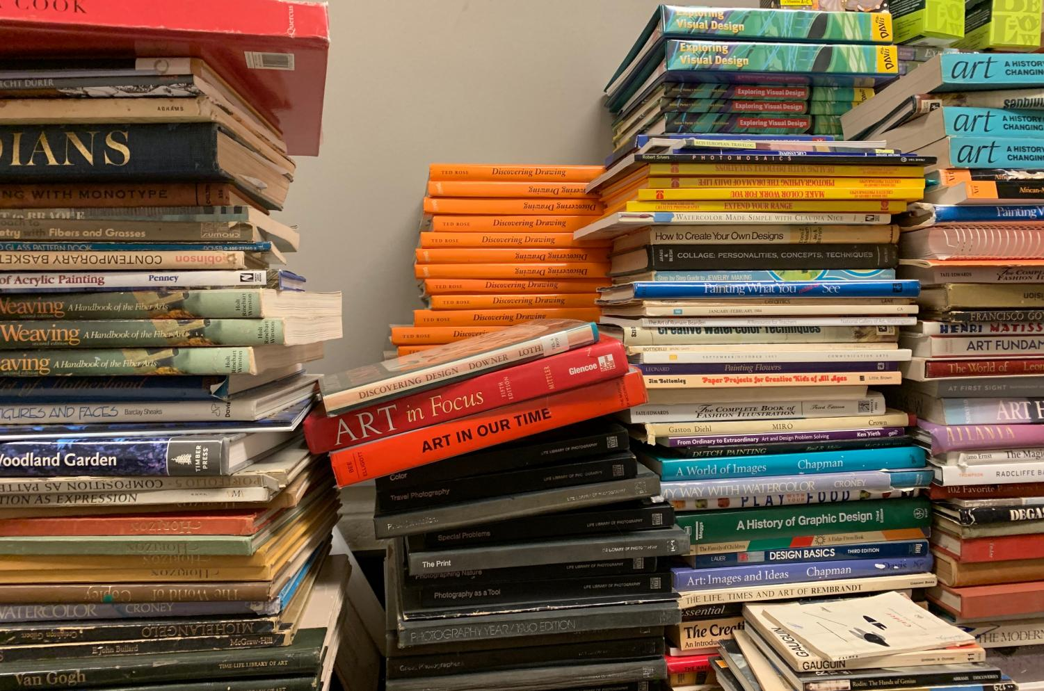 Art history textbooks scattered around the art classroom.