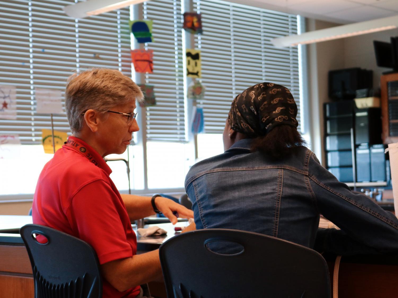 Science teacher DeAnn Peterson helps a student during STAR period.