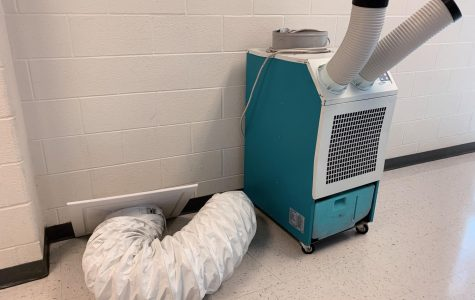 A lone HVAC unit in the second floor stairwell.