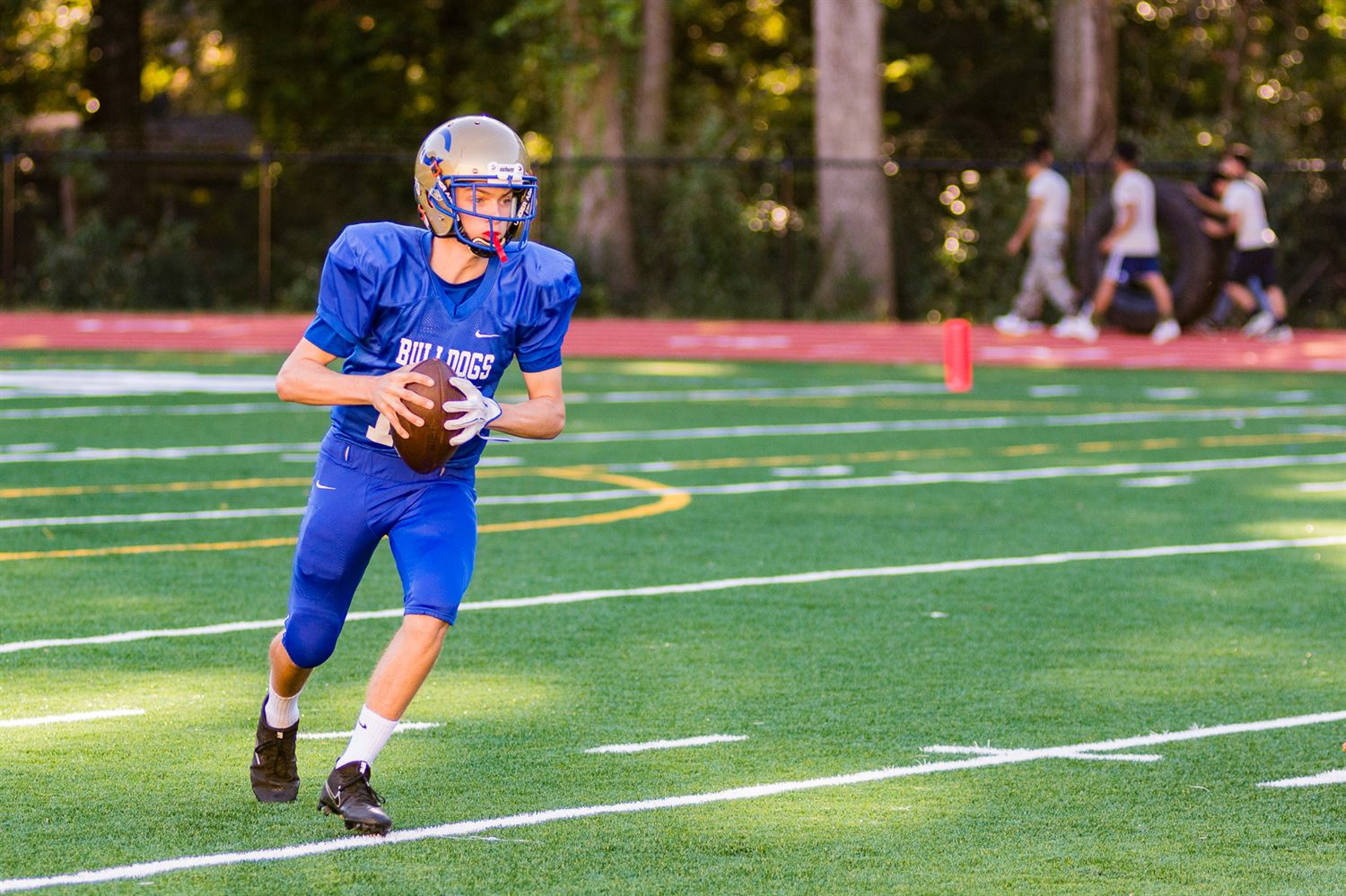 Quarterback Finn Allers playing football prior to his injury.
