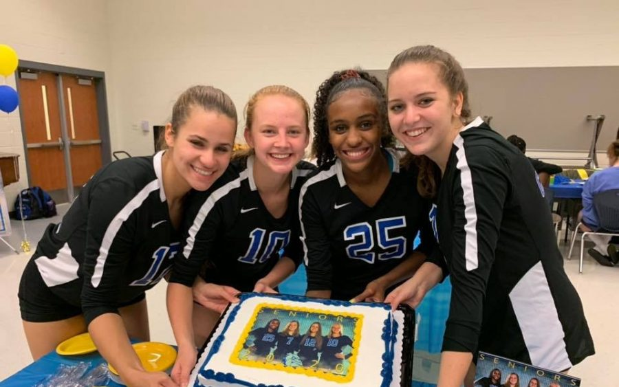 Volleyball+seniors+%28Left+to+Right%29+Kitzler%2C+Samford%2C+Carpenter%2C+and+Evans+celebrate+their+athletic+achievements.