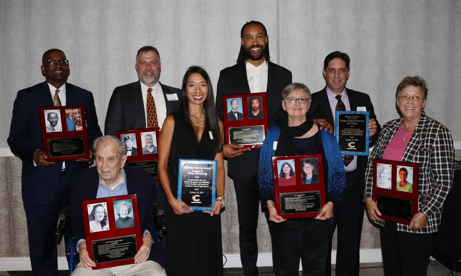 Inductees and award recipients pose for a picture at the Blue and Gold Hall of Fame.
