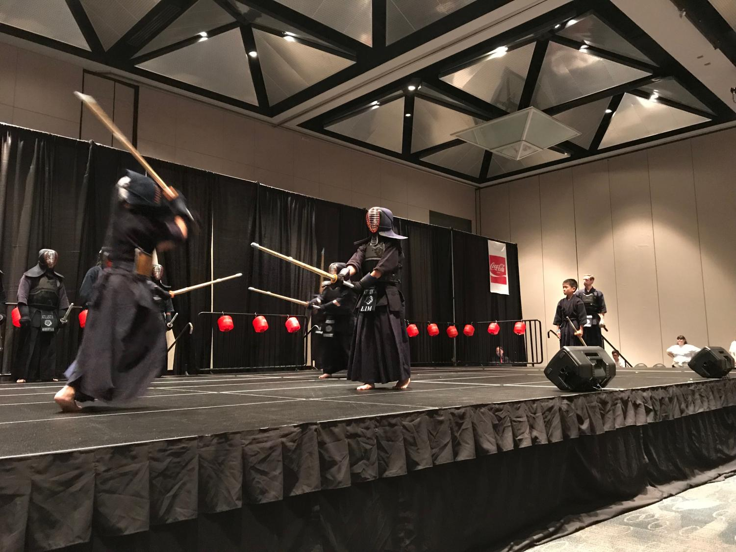 Victor Lim (right) during a kendo match.