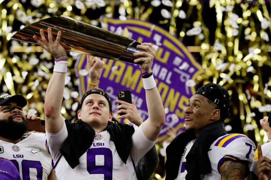 Quarterback+Joe+Burrow+hoists+the+National+Championship+Trophy+after+defeating+the+Clemson+Tigers+42-25.