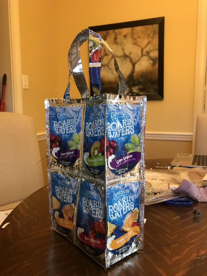 Olivia Castro & her group made this lunchbox out of recycled CapriSun pouches for APES.