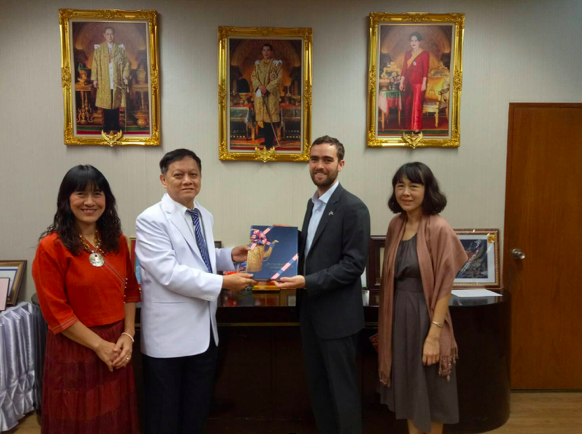 Daniel Jacobs-Nhan (second from right) meets with medical officials from the Thai government.