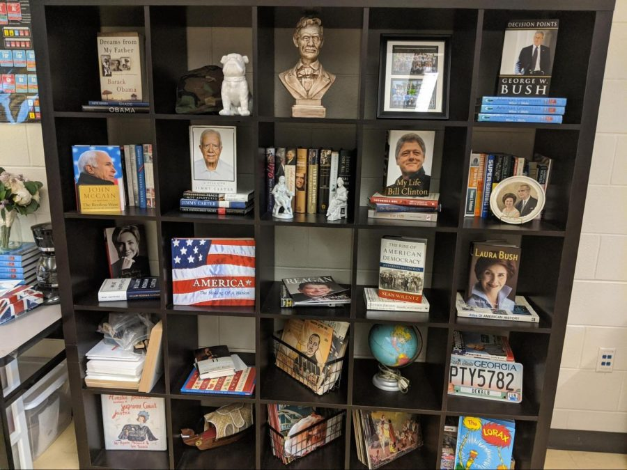 A cabinet in Ms. Kaspar's room with much social studies themed decor.