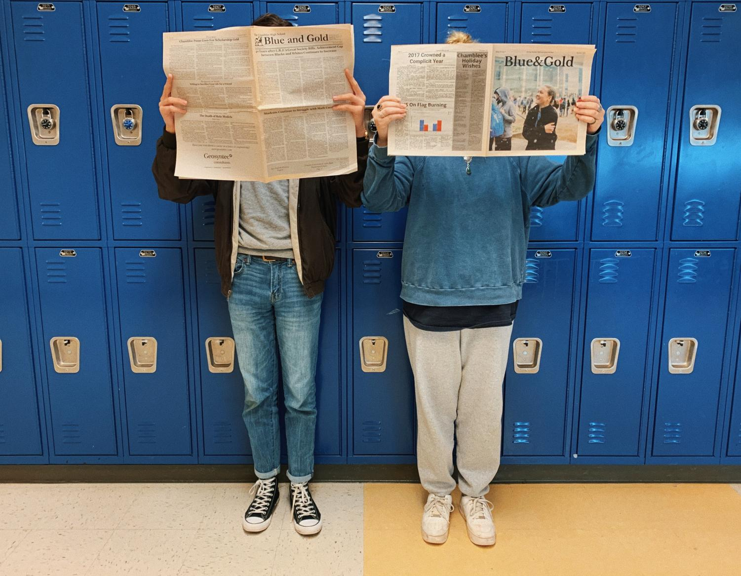 Editors Foster Cowan and Stella Garrett hold up some copies of The Blue & Gold.