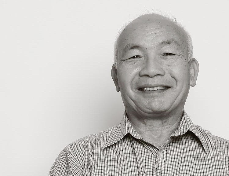 Phe Nguyen posing for a National Art Honor Society portrait.