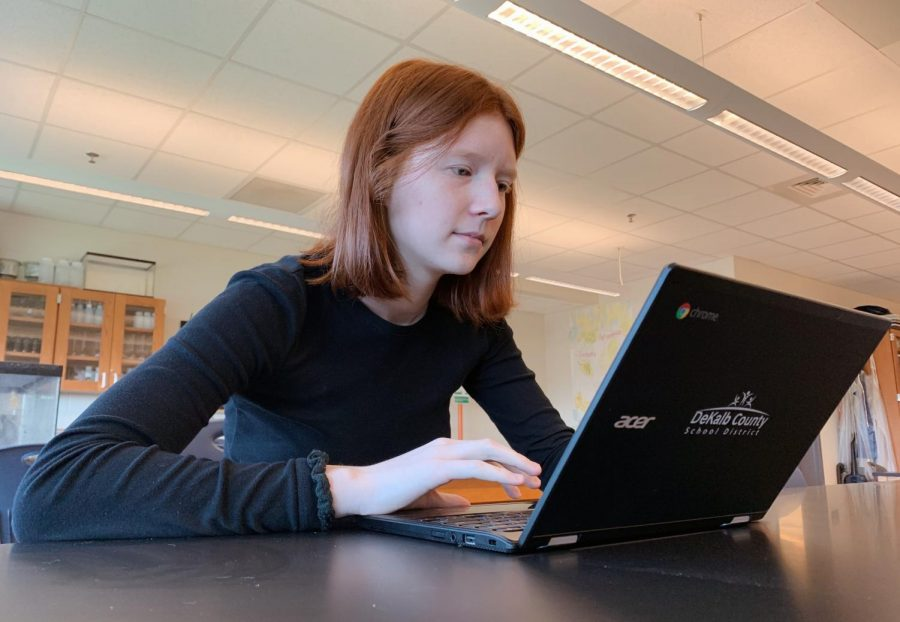 Senior+Emery+Wahlen+uses+her+Chromebook+in+class%2C+despite+having+trouble+with+the+device%27s+performance+previously.