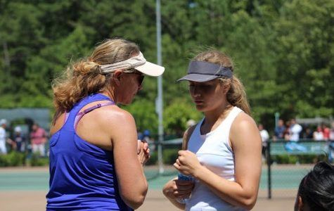 Tennis Coach Larisa Tulchinsky (left) and her daughter prepare for a tennis match.