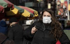 A woman in New York wears a surgical mask amid fears of coronavirus.
