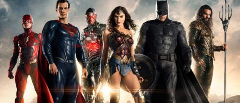 Superheroes from the DC Universe are pictured standing together.