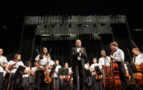 Mr. Kuutti and his students receive applause after a successful performance