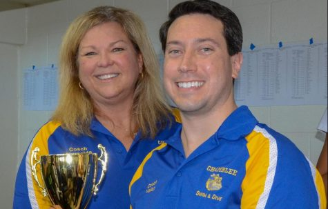 Gregory Valley poses with Lorri Reynolds, while receiving a state swim trophy.