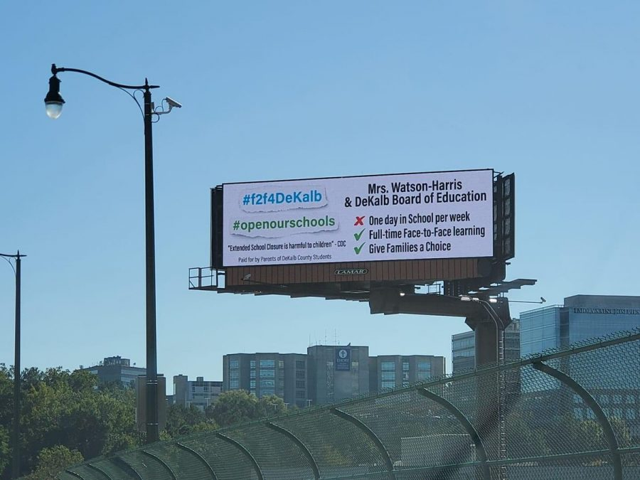 Billboard in DeKalb calling for the reopening of schools.