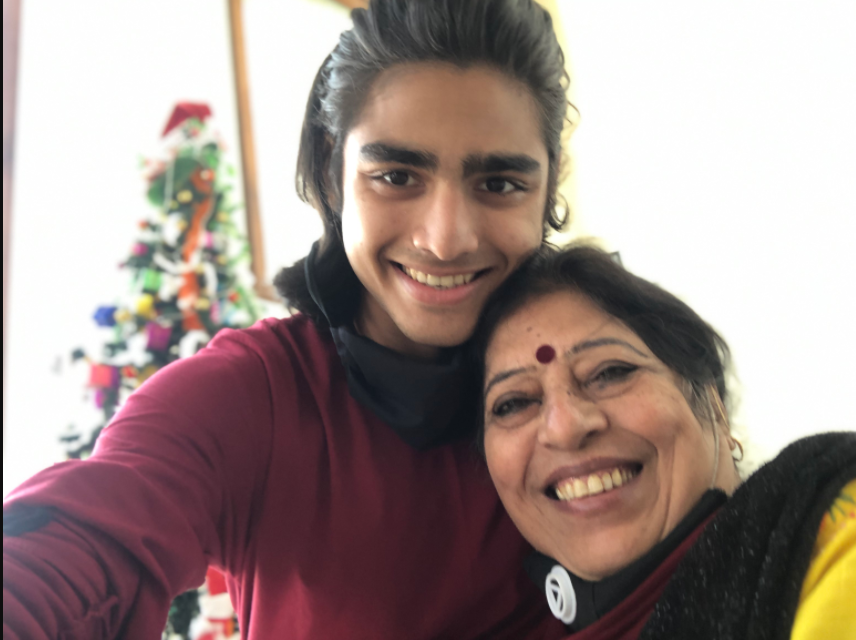 Rudraksha Bhukhanwala ('22) poses with his grandmother in front of their Christmas tree.