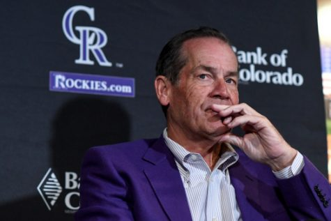 Rockies owner Dick Monfort looks on during a press conference.