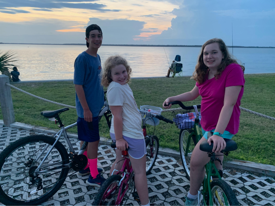 Luke Williams biking with his sisters.