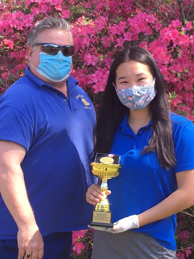 Golf coach Kurt Koeplin poses with Olivia Li, who finished second overall in individual score at the county championships