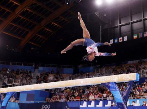 Olympic gymnast Simone Biles shows off her skills.