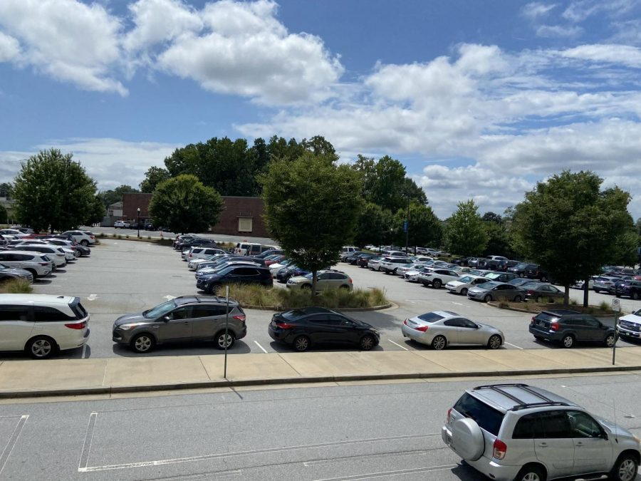 The main parking lot filled with staff vehicles.