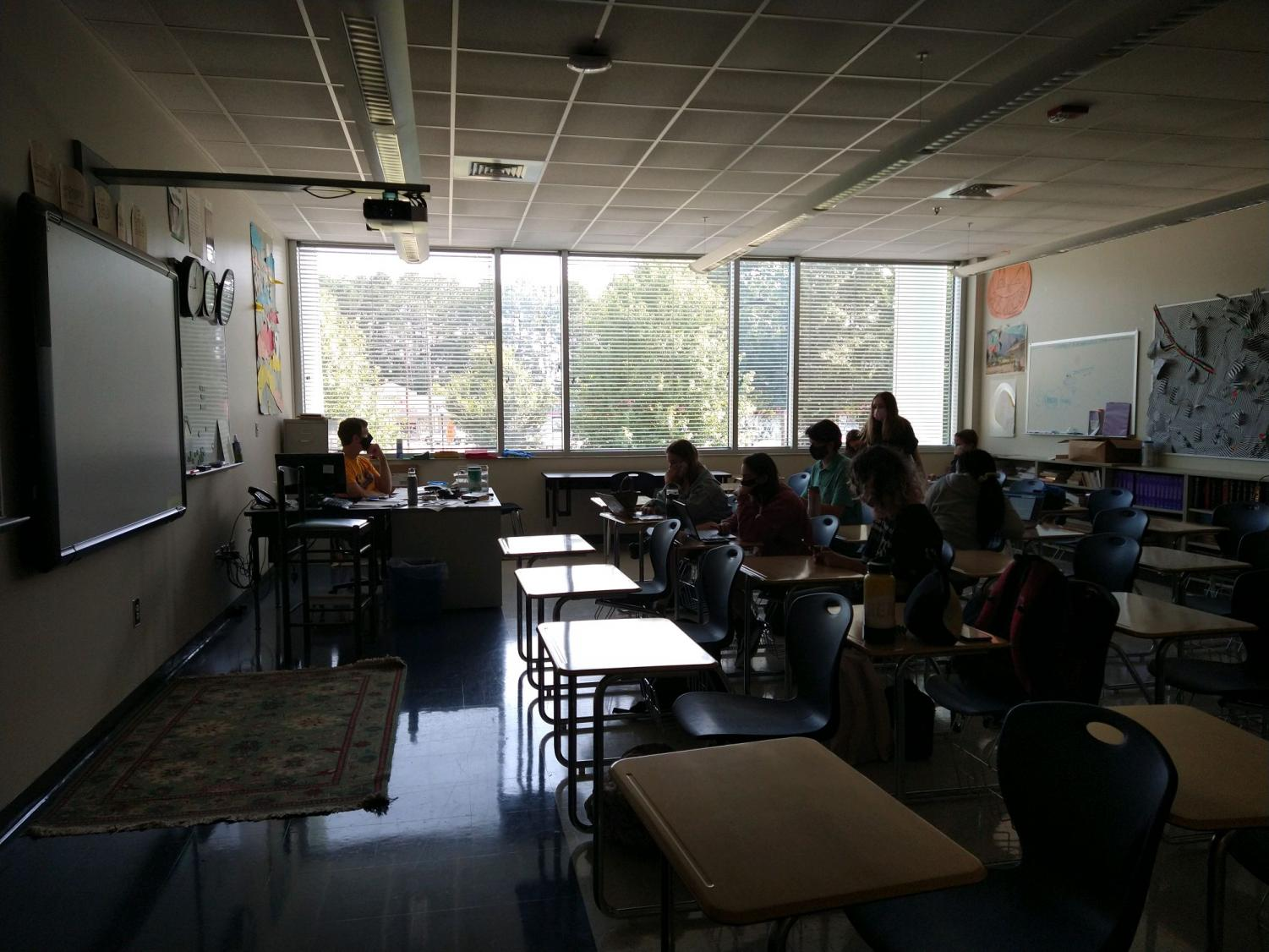 Journalism students learn safely in a classroom.