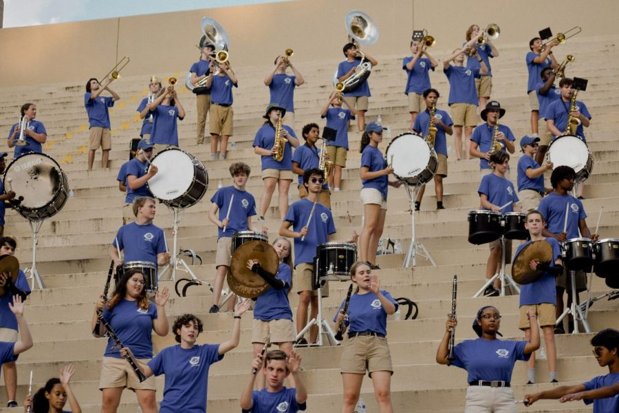 The marching band plays to support the football team.