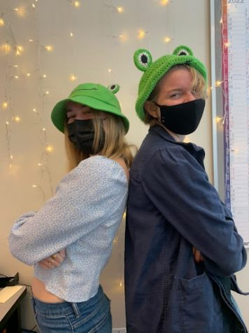 Seniors Natalie Brown (left) and Carly Aitken (right) posing in their frog hats for hat day
