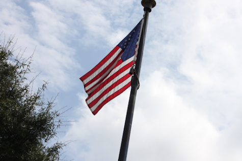An American flag waves in the wind in Chamblee