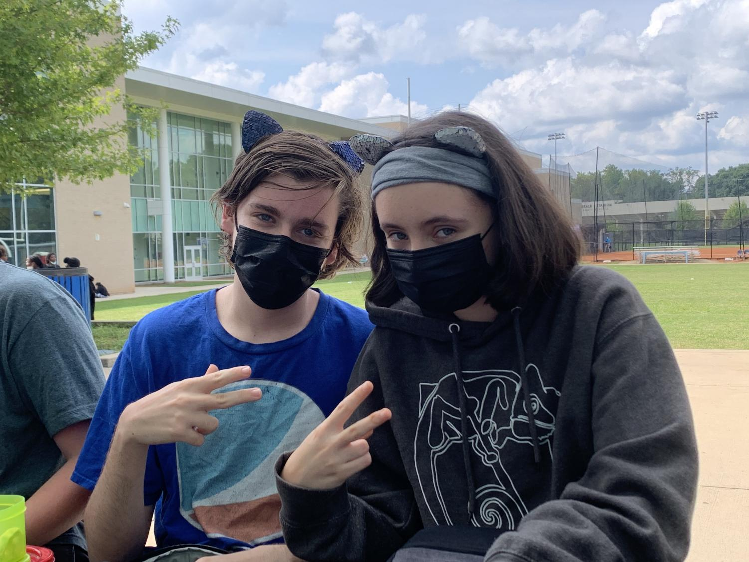 Students Owen Thorp (left) and Camille Thorp (right) pose with cat ears and peace signs