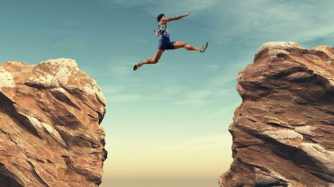 A long jumper leaps over a chasm