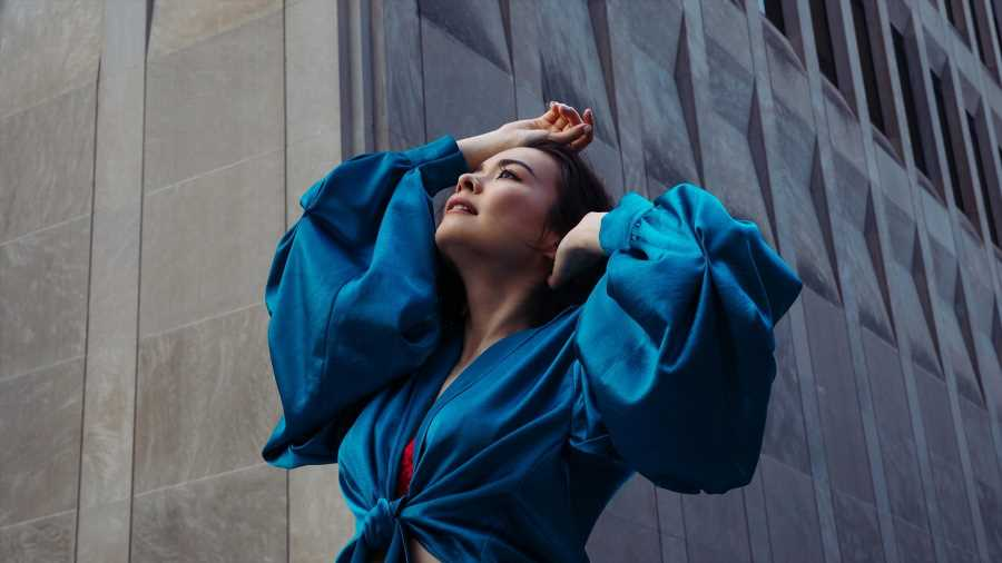 Singer-songwriter Mitski in her new song Working for the Knife.